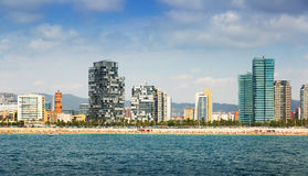 Barcelona from sea side. Beach and New houses at Sant Marti district stock image