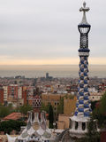 Barcelona seen from park Guell. Park Guell  garden complex was designed by the Catalan architect Antoni Gaudi and built from  1900 to 1914. It is part of the Royalty Free Stock Photo