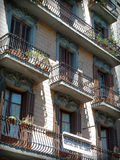 Barcelona siesta. Full frame capture of balconies on a traditional Catalan apartment block in Barcelona. The shutters are closed to shield the apartments from royalty free stock photo