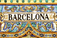 Barcelona sign. A barcelona sign over a mosaic wall Stock Photo