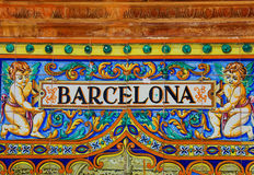 Barcelona sign over a mosaic wall. Famous ceramic decoration in Plaza de Espana, Sevilla, Spain. Barcelona theme Royalty Free Stock Photo
