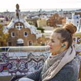 Traveller woman in Barcelona listening audioguide Royalty Free Stock Photos
