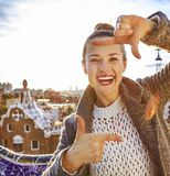 Smiling traveller woman in Barcelona, Spain framing with hands Royalty Free Stock Images