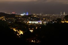 Barcelona skyline and cityscape by night. Panorama of illuminated night city from hills, lighting of buildings, visual pollution royalty free stock images