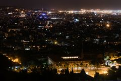 Barcelona skyline and cityscape by night. Panorama of illuminated night city from hills, lighting of buildings, visual pollution stock photography