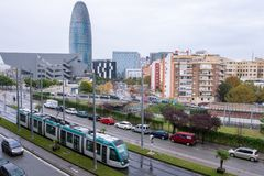 Barcelona skyline disctrict. Tram moving in Barcelona with skyline in the background royalty free stock images