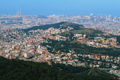 Barcelona skyline at dusk Stock Images