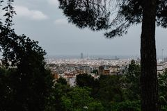Barcelona skyline through a park. Barcelona`s skyline through an opening of trees in a park stock photo