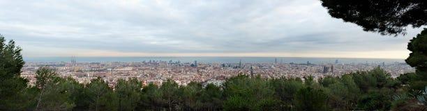 Barcelona skyline at sunset Stock Images