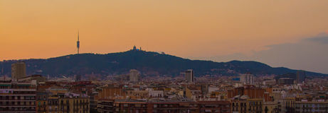 Barcelona Skyline at sunset. Panorama of Barcelona skyline, with buildings in the foreground and mountains in the background, at sunset Royalty Free Stock Photo