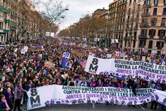Barcelona, Spain - 8 march 2020: women march in the city center during woman`s day for better human rights for women and feminism