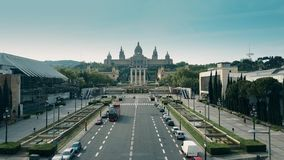 BARCELONA, SPAIN - APRIL, 15, 2017. Aerial shot of tour bus and Palau Nacional - National Palace on a sunny day. 4K stock video