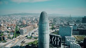 BARCELONA, SPAIN - APRIL, 15, 2017. Famous Torre Agbar skyscraper. City and sea aerial view on a sunny day. 4K stock footage
