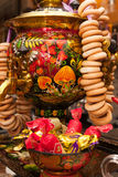 Barcelona, Spain - April 5, 2016:Khokhloma painted traditional Russian samovar with bunch of Bagels in Russian cuisine restaurant Stock Photos