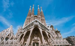 BARCELONA, SPAIN - April 25, 2018: La Sagrada Familia - the impressive cathedral designed by Gaudi, which is being build. Since 19 March 1882 and planed finally Stock Photos
