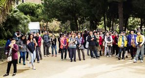Tourists admiring La Sagrada Familia in Barcelona. BARCELONA, SPAIN - APRIL 6, 2018: A large group of tourists admiring and taking pictures of the famous La Stock Photo
