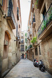 Barcelona, Spain - April 17, 2016: Medieval buildings in the Gothic distric Royalty Free Stock Image