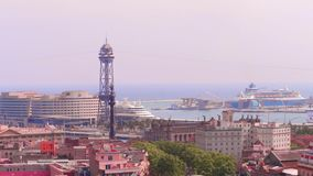 BARCELONA, SPAIN - APRIL, 15, 2017. Port cable car and distant moored cruise ships. 4K video. BARCELONA, SPAIN - APRIL, 15, 2017. Port cable car and distant stock footage