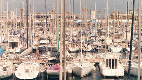 BARCELONA, SPAIN - APRIL, 15, 2017. Steadicam shot of moored sailboats at the marina piers. 4K clip. BARCELONA, SPAIN - APRIL, 15, 2017. Steadicam shot of moored stock video