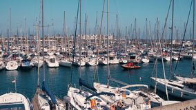 BARCELONA, SPAIN - APRIL, 15, 2017. Steadicam shot of moored sailboats at the marina piers. 4K video. BARCELONA, SPAIN - APRIL, 15, 2017. Steadicam shot of stock video footage