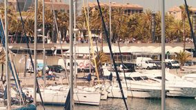 BARCELONA, SPAIN - APRIL, 15, 2017. Steadicam shot of moored sailboats and motorboats at the marina embankment. 4K clip. BARCELONA, SPAIN - APRIL, 15, 2017 stock video footage