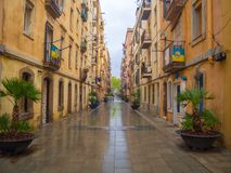 Barcelona, Spain - April 11, 2018: Street in the neighborhood of Barceloneta a day of heavy rain. A fishing and tourist district Stock Photos