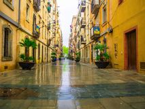 Barcelona, Spain - April 11, 2018: Street in the neighborhood of Barceloneta a day of heavy rain. A fishing and tourist district Royalty Free Stock Image