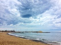 Barcelona, Spain, April 2018: View on sandy beach of Barcelona. royalty free stock image