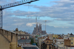 BARCELONA, SPAIN - APRIL 28:  View of the Sagrada Familia from the roof terrace of Gaudi Casa Mila or La Pedrera on April 28, 2016. View of the Sagrada Familia Stock Photography