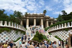 BARCELONA, SPAIN - AUG 30th, 2017: Entrance at the Park Guell designed by Antoni Gaudi with tourists at the stairs. Catalonia stock photography