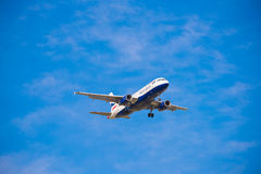 BARCELONA, SPAIN - AUGUST 20, 2016: British Airways plane in the blue sky. Copy space for text. Stock Photos