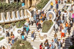 Guell park in Barcelona. BARCELONA, SPAIN - August 17, 2017: Close-up view on the Dragon stairway with tourists in Guell park, famous public park with gardens Stock Photos