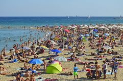 Hot weather people on the beach in Barcelona Spain stock image