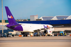 BARCELONA, SPAIN - AUGUST 20, 2016: Express FedEx plane at the cargo terminal. Copy space for text. Stock Photos
