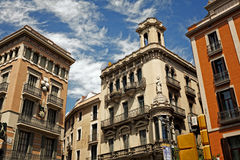 Facades on the street La Rambla Stock Images
