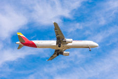 BARCELONA, SPAIN - AUGUST 20, 2016: Iberia Airlines plane arriving at Airport on schedule. Copy space for text. Royalty Free Stock Photo