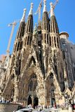 Barcelona, Spain, August 2016. The main facade of the cathedral of the holy family and construction cranes. Barcelona, Spain, August 2016. Numerous tourists and stock images