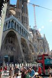 Barcelona, Spain, August 2016. Numerous tourists and buses in front of the Cathedral of the Holy Family. The famous unfinished cathedral of the architect Gaudi stock image