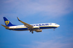 BARCELONA, SPAIN - AUGUST 20, 2016: The plane Ryanair in the blue sky. Copy space for text. Stock Images