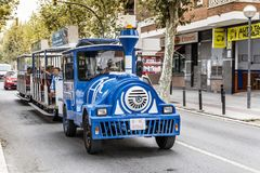 Blue trackless train  in  Barcelona,Spain Stock Photography
