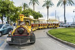 Yellow trackless train  in  Barcelona,Spain Stock Photo