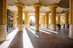 Park Guell in Barcelona. BARCELONA, SPAIN - August 17, 2017: View on the columns of the main terrace in Guell park, famous public park with gardens and Royalty Free Stock Photos