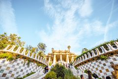 Guell park in Barcelona. BARCELONA, SPAIN - August 17, 2017: View on the Dragon stairway and terrace with tourists in Guell park, famous public park with gardens Royalty Free Stock Photo