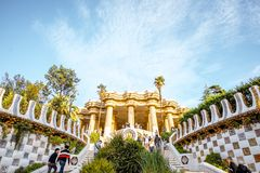 Guell park in Barcelona. BARCELONA, SPAIN - August 17, 2017: View on the Dragon stairway and terrace with tourists in Guell park, famous public park with gardens Stock Photography