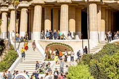 Guell park in Barcelona. BARCELONA, SPAIN - August 17, 2017: View on the Dragon stairway and terrace with tourists in Guell park, famous public park with gardens Stock Photo
