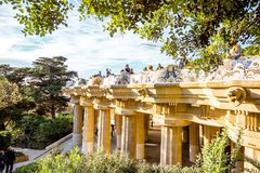 Park Guell in Barcelona. BARCELONA, SPAIN - August 17, 2017: View on the main terrace full of tourists in Guell park famous public park with gardens and Stock Photos