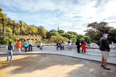 Park Guell in Barcelona. BARCELONA, SPAIN - August 17, 2017: View on the main terrace full of tourists in Guell park famous public park with gardens and Stock Photo