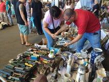 Barcelona, Spain - August 21, 2016: Visitors inspect examine various range of retro goods merchandise on flea market. El Cants in Barcelonan Stock Image