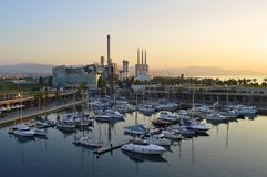 Morning harbor and industrial towers Barcelona Spain stock photography