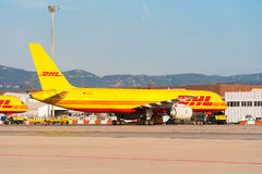 BARCELONA, SPAIN - AUGUST 20, 2016: A yellow Boeing 757 cargo airplane from logistics courrier company DHL. Copy space. Royalty Free Stock Photos